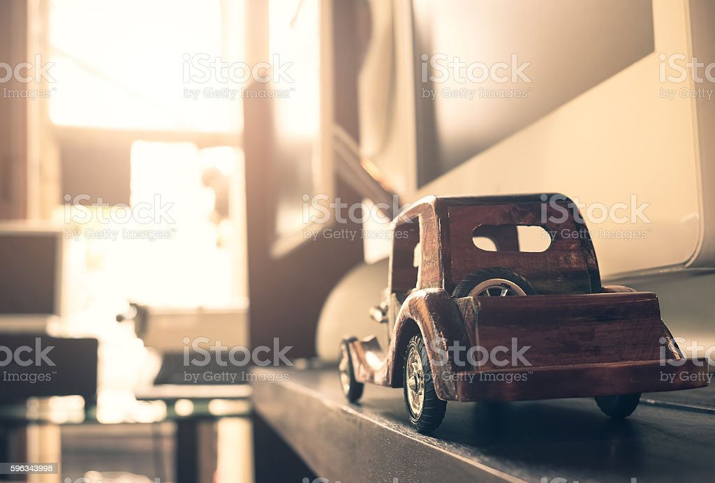 vintage wooden toy car on hardwood. Lizenzfreies stock-foto