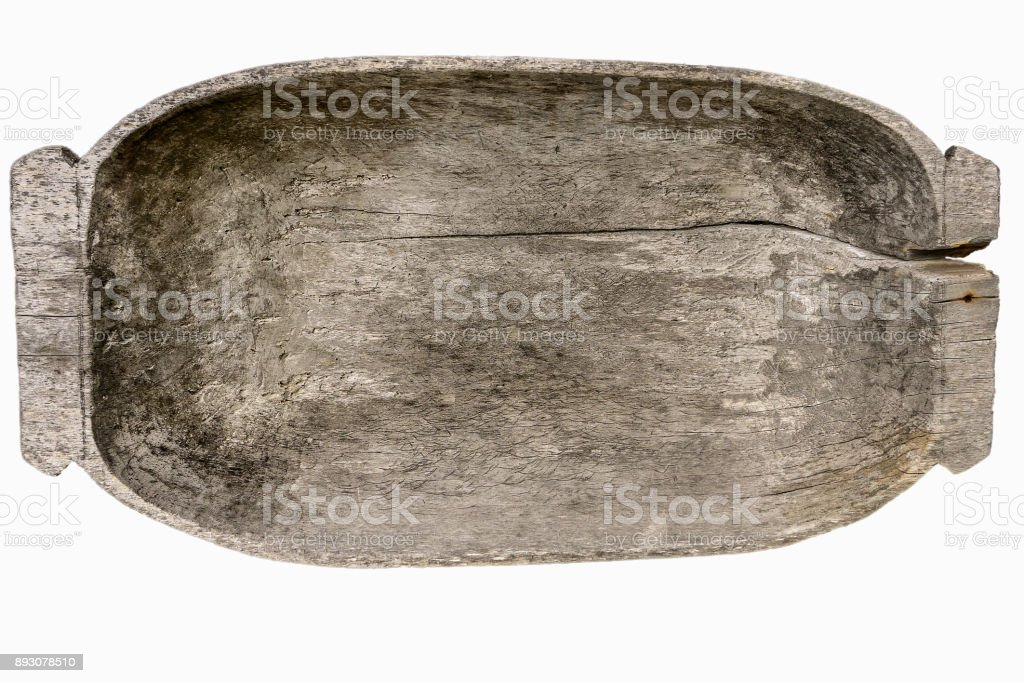 Vintage wooden trough, used, cracked, with spots of  wood-decay fungus. Old household equipment. Isolated on white. stock photo