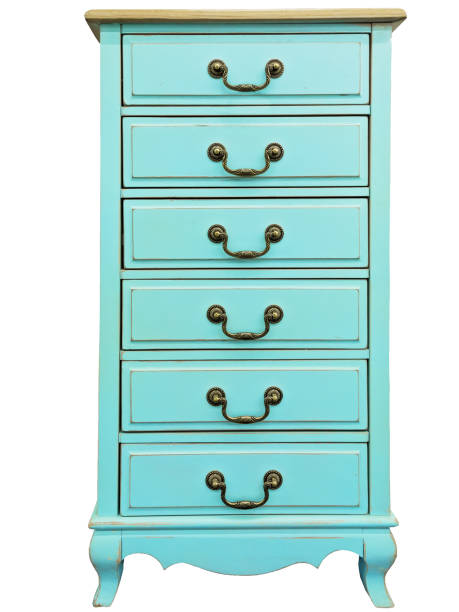 Vintage wooden turquoise chest of drawers isolated on white background. Chest of 6 six drawers stock photo