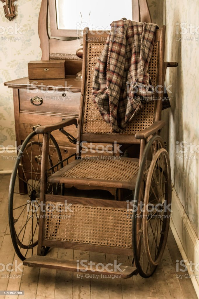 Vintage wooden wheelchair stock photo