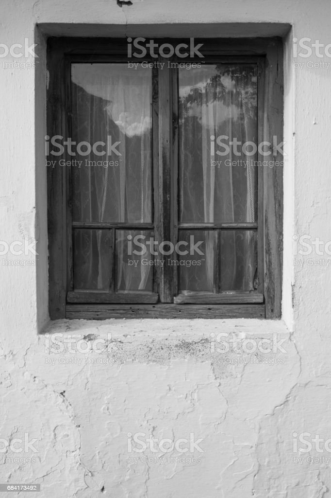 Vintage wooden window on old cracked facade royalty-free stock photo