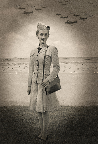 Multiple exposure digital image of a World War 2 Female Navy Officer reenacting Omah Beach on D-Day. Complete with authentic fighter planes and landing craft.