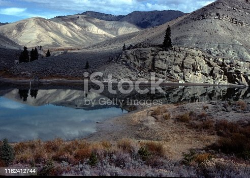 Vintage, authentic archival photograph of beautiful nature scene with lake and clouds in Wyoming, 1976