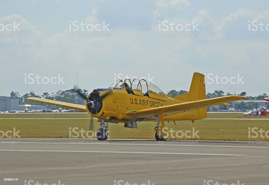 Vintage yellow airplane on runway royalty-free stock photo