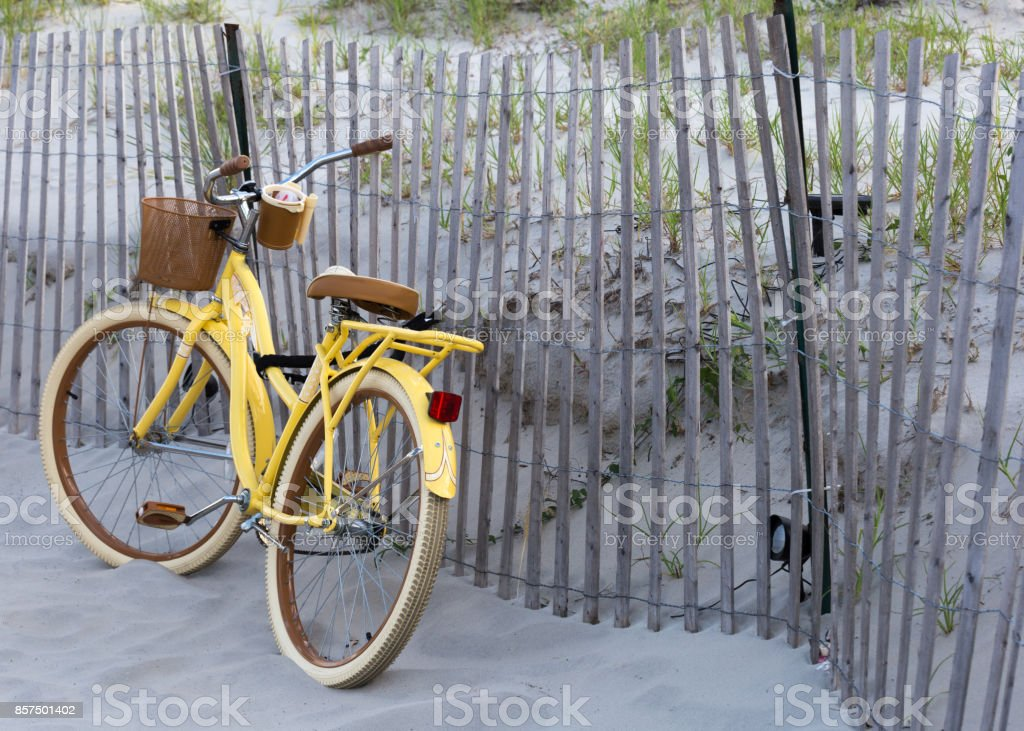 Vintage yellow bicycle on the beach stock photo