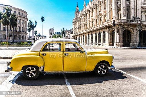 istock Vintage Yellow Car In Front Of Gran Teatro of Havana, Cuba 1074246072