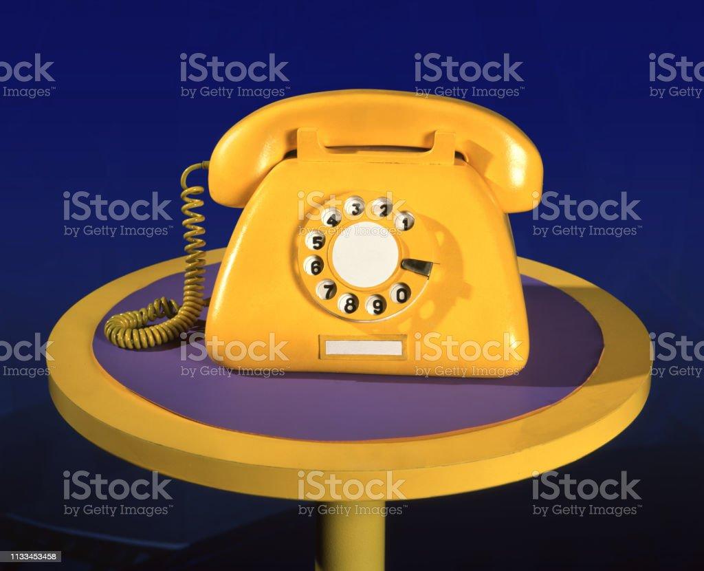 Vintage gele nep-telefoon foto