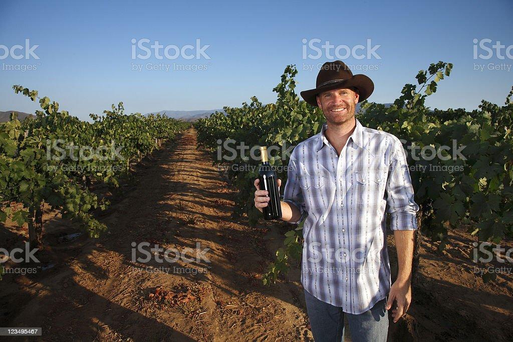 vintner holding wine bottle royalty-free stock photo