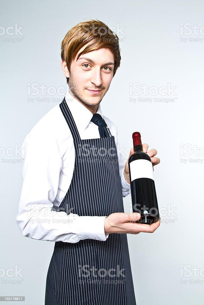 Winzer mit einer Flasche Wein – Foto
