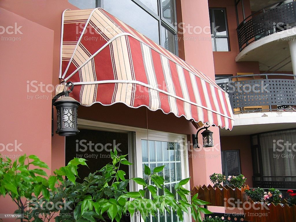 Vinyl awning over a apartment patio stock photo