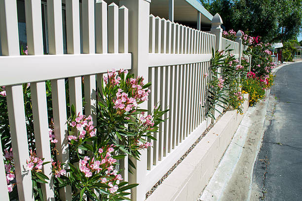 vinyl fencing on older home - fence stock photos and pictures