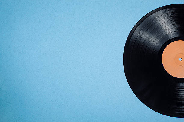 vinyl musical disc on blue background; stock photo