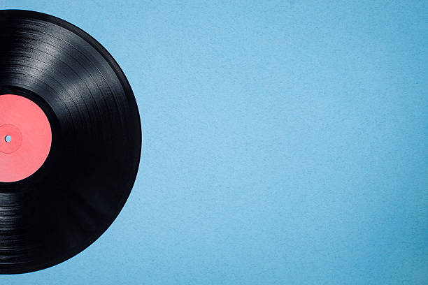vinyl musical disc on blue background; - foto stock