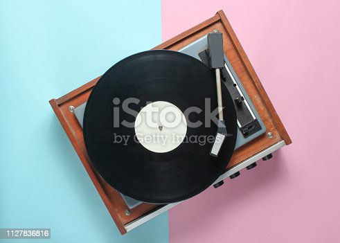 istock Vinyl player on a blue pink pastel background. Top View 1127836816