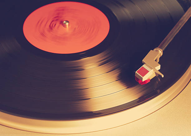 vinyl player vintage vinyl player, retro film filtered analogue audio storage media stock pictures, royalty-free photos & images