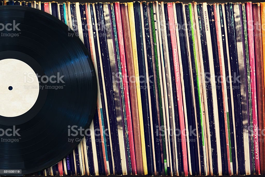 Vinyl record and collection of albums (dummy titles) stock photo