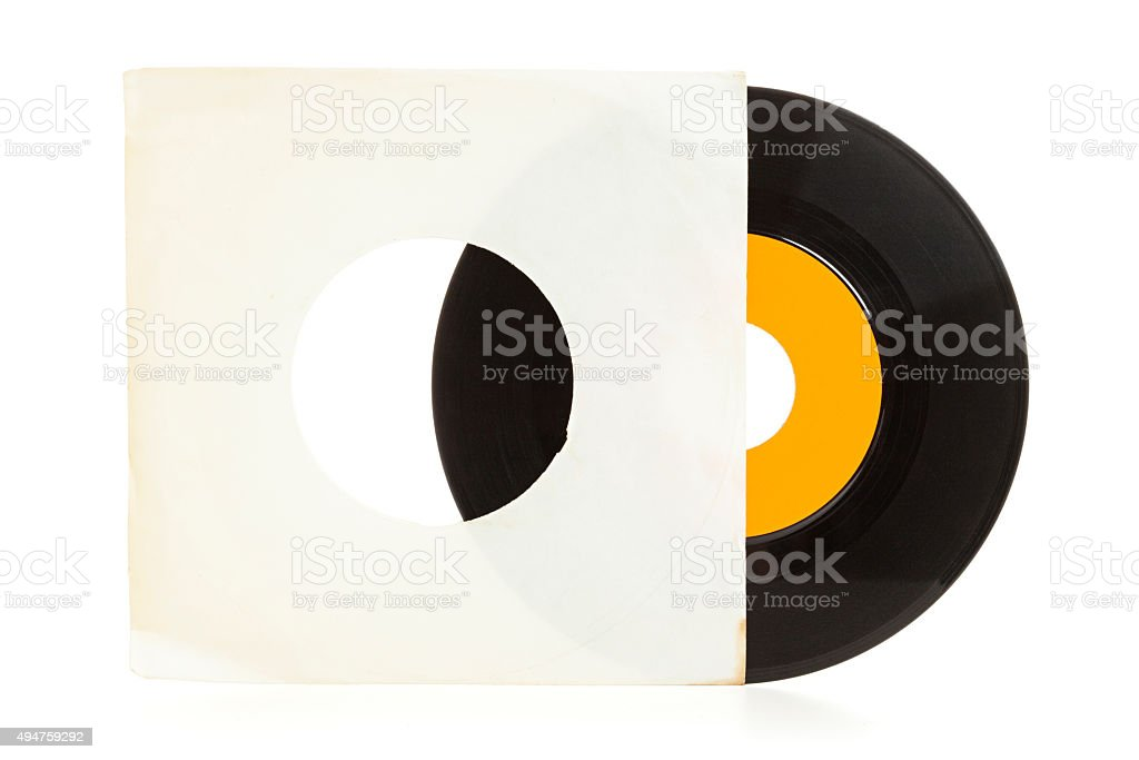 Vinyl record coming from old blank sleeve stock photo