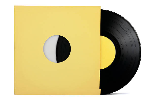 A vinyl record inside of a yellow sleeve stock photo