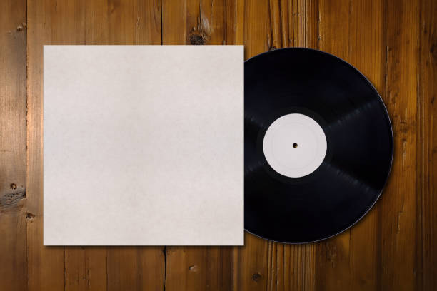 Vinyl record mockup with copy space Close-up on wood board with on its middle a vinyl record mockup with copy space. album stock pictures, royalty-free photos & images