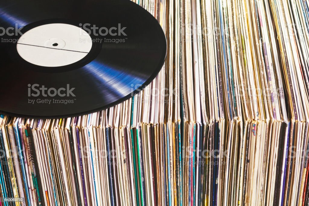 Vinyl record on a collection of albums stock photo