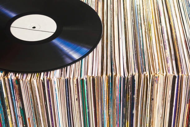 vinyl record on a collection of albums - records stock photos and pictures