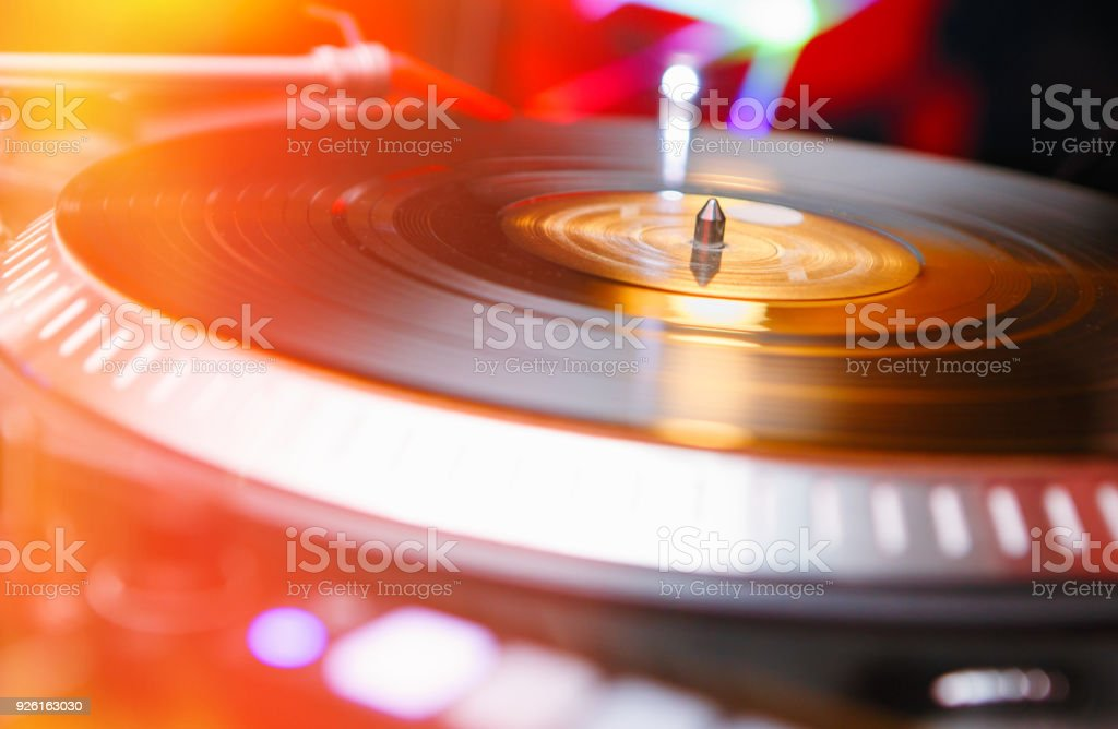 Vinyl record player turn table in bright stage lights stock photo