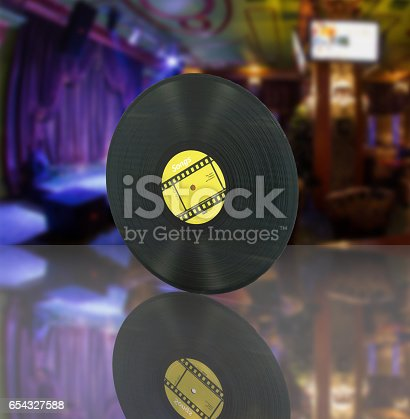 istock vinyl record retro sound on bar background with reflection 3d 654327588