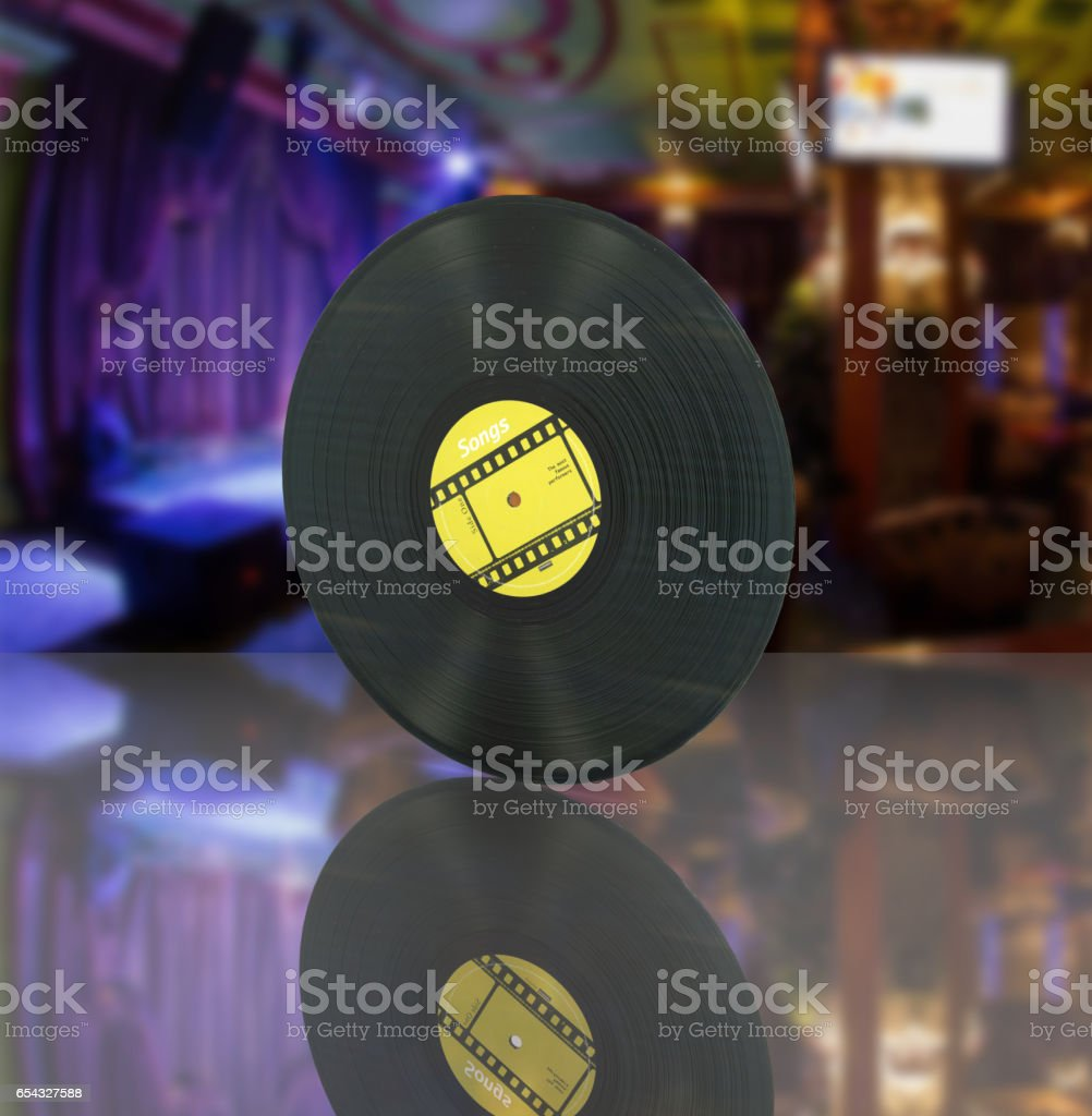 vinyl record retro sound on bar background with reflection 3d stock photo