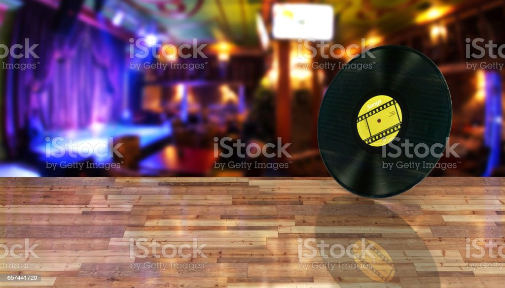 vinyl record retro sound on bar background with reflection on wood floor 3d stock photo