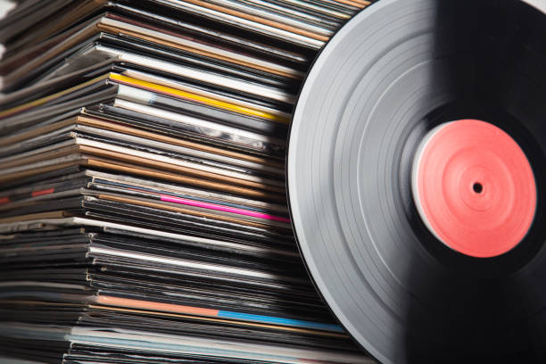 vinyl records closeup - records stock photos and pictures