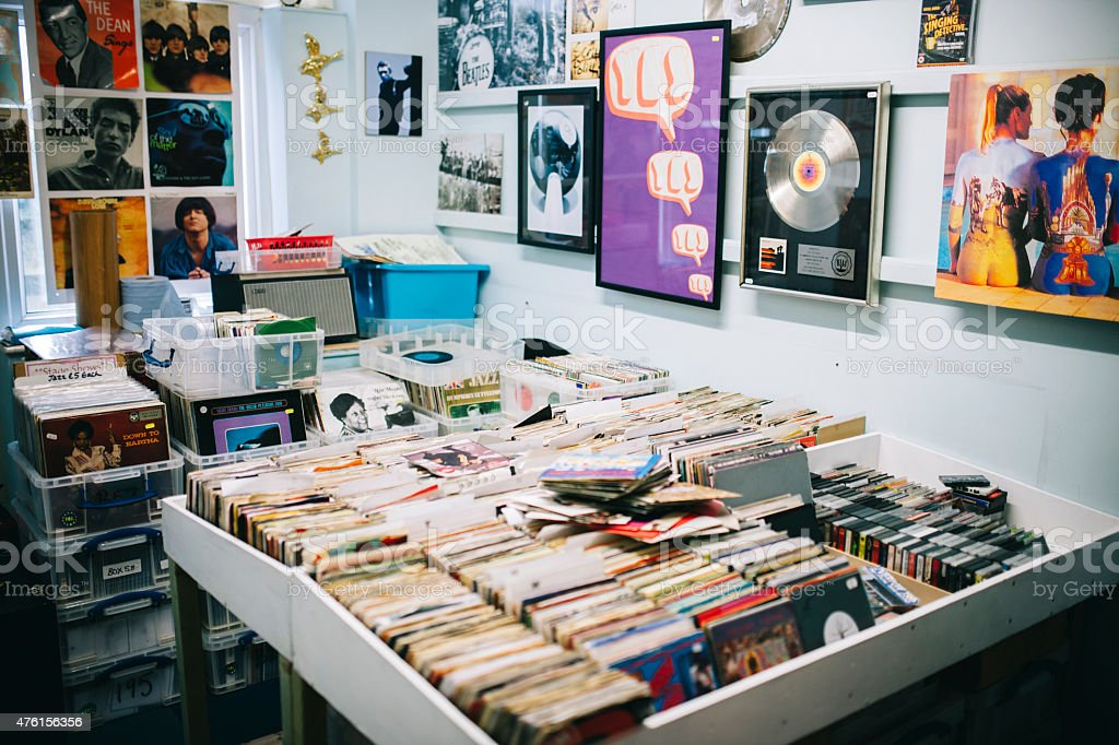 Vinyl records for sale, a record shop, Pop music posters stock photo