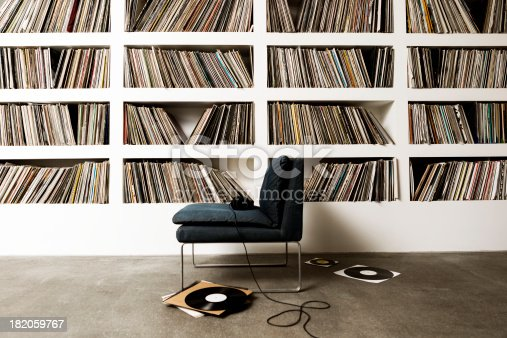 A collection of vinyl records on shelfs.