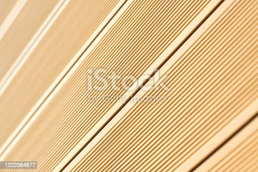 Vinyl siding texture, light beige color. Modern plastic wall cladding protective material for houses and small apartment buildings. Wood clapboard imitation
