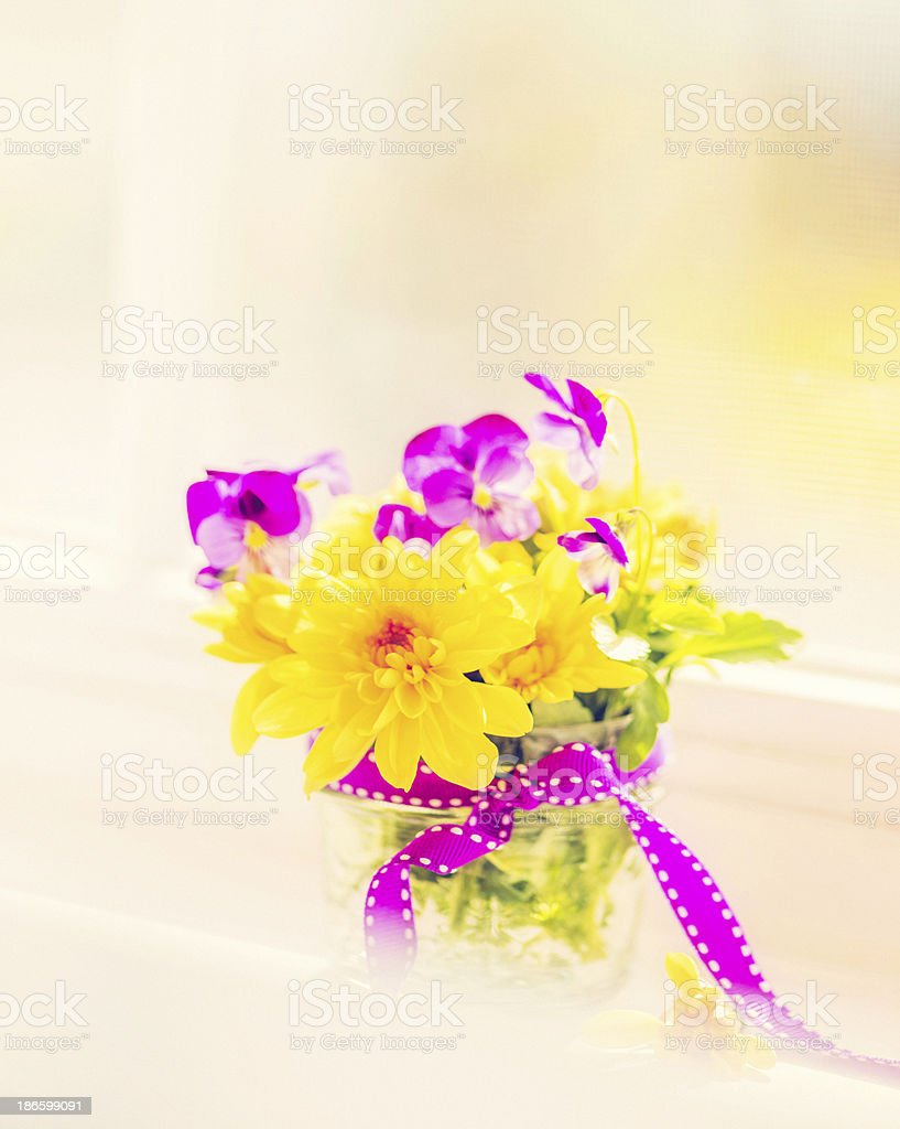 Viola and Chrysanthemum Bouquet in Window royalty-free stock photo