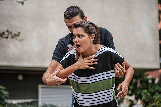 Violence on women A young woman is being molested self defense stock pictures, royalty-free photos & images