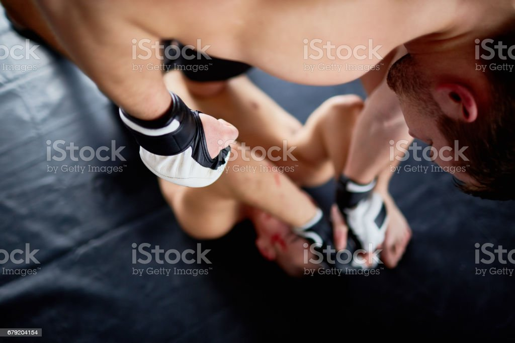 Violent Fight in Boxing Ring stock photo