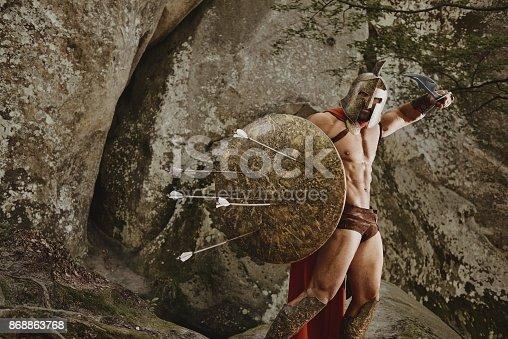 istock Violent warrior in gladiator armor 868863768