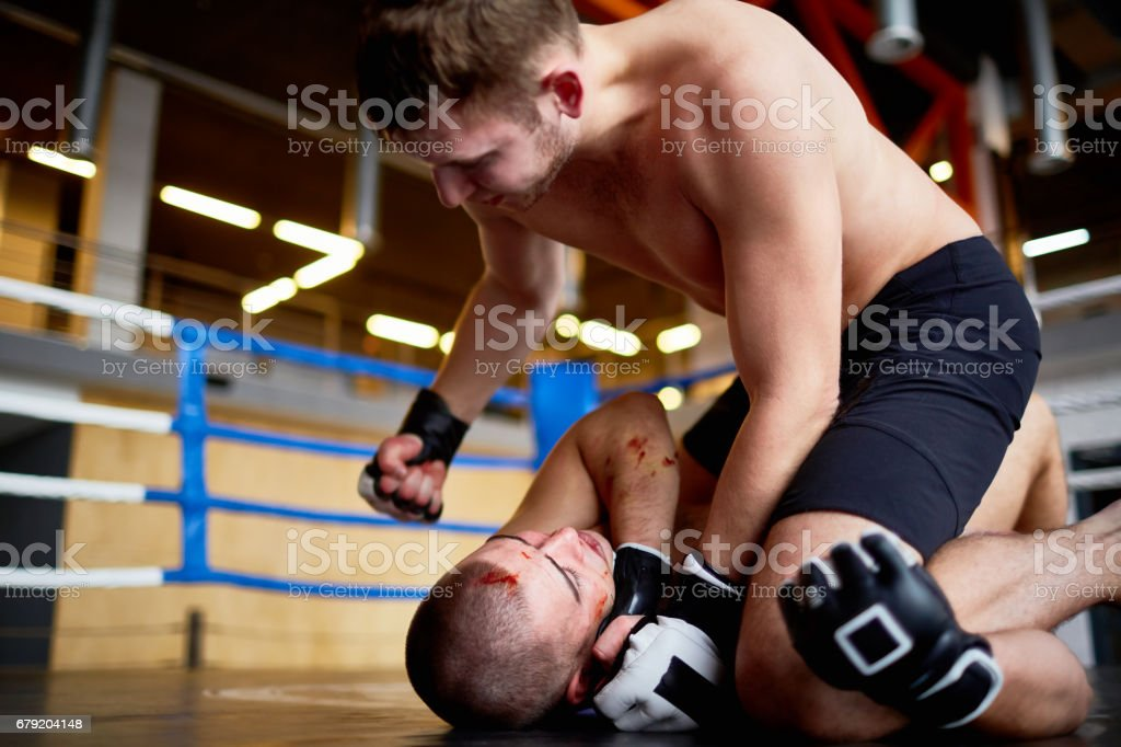 Violent Wrestling Fight in Boxing Ring stock photo