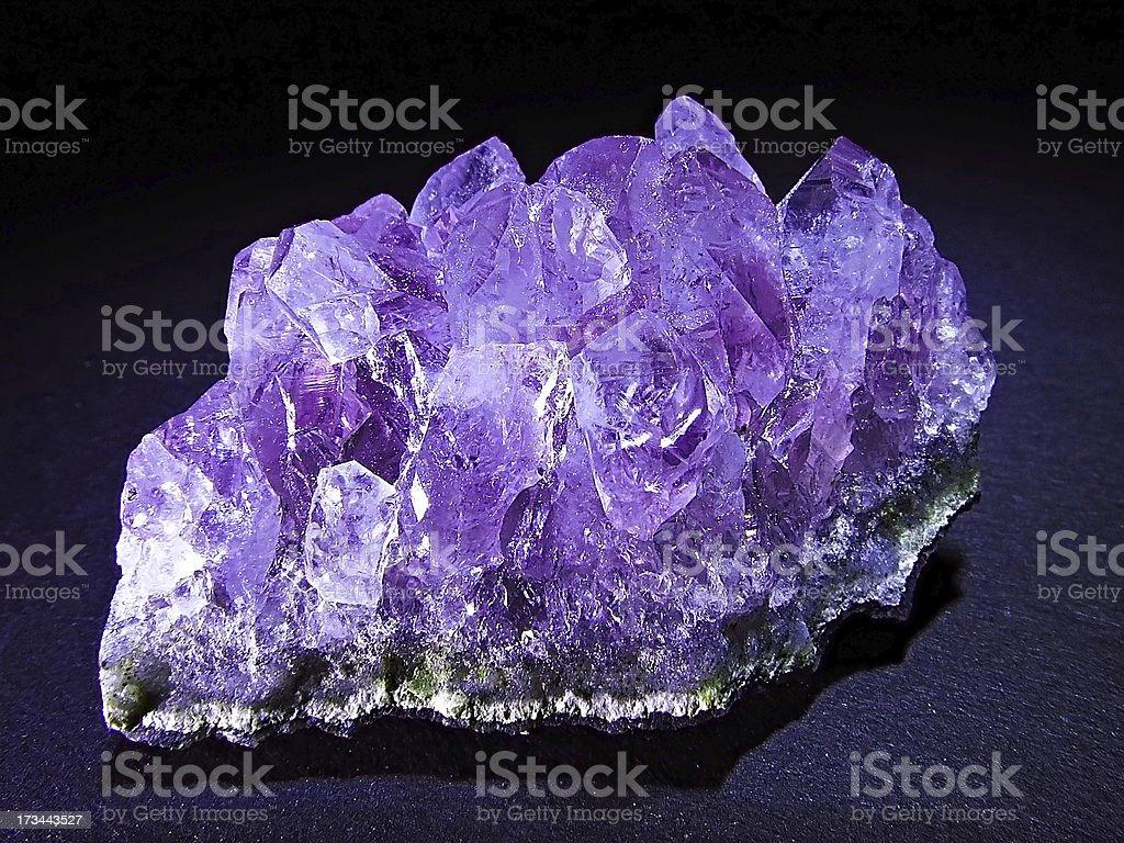 Violet amethyst glow in the dark royalty-free stock photo