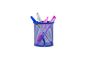 Violet and blue pens in dark blue metal vase isolated on white background