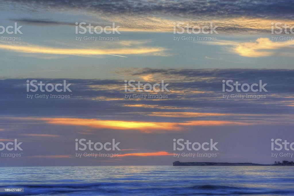 Violet and orange clouded sunset royalty-free stock photo