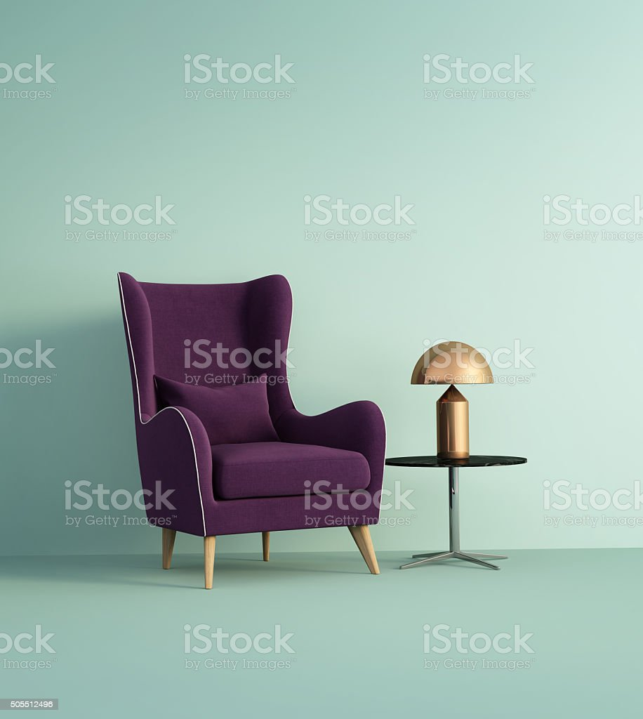 Violet armchair over pale green wall stock photo