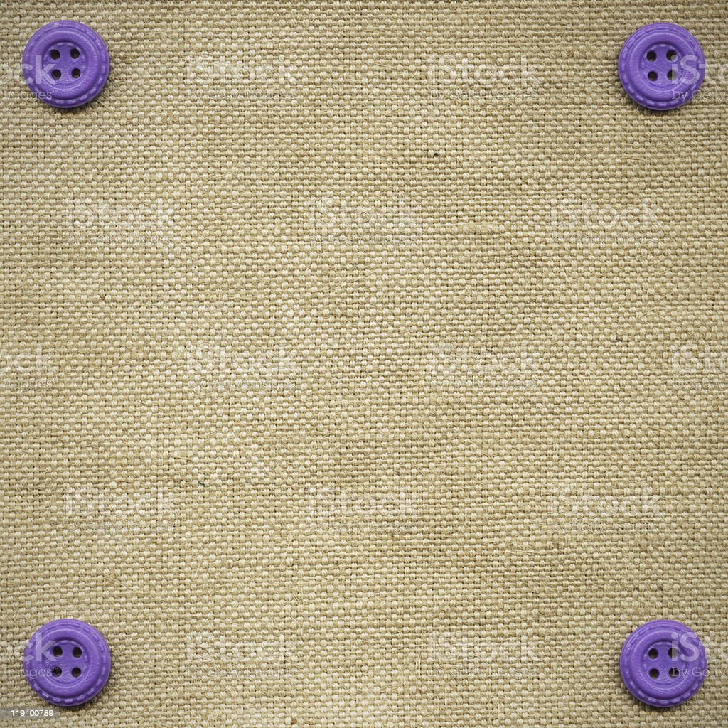 Violet buttons on the beige fabric royalty-free stock photo