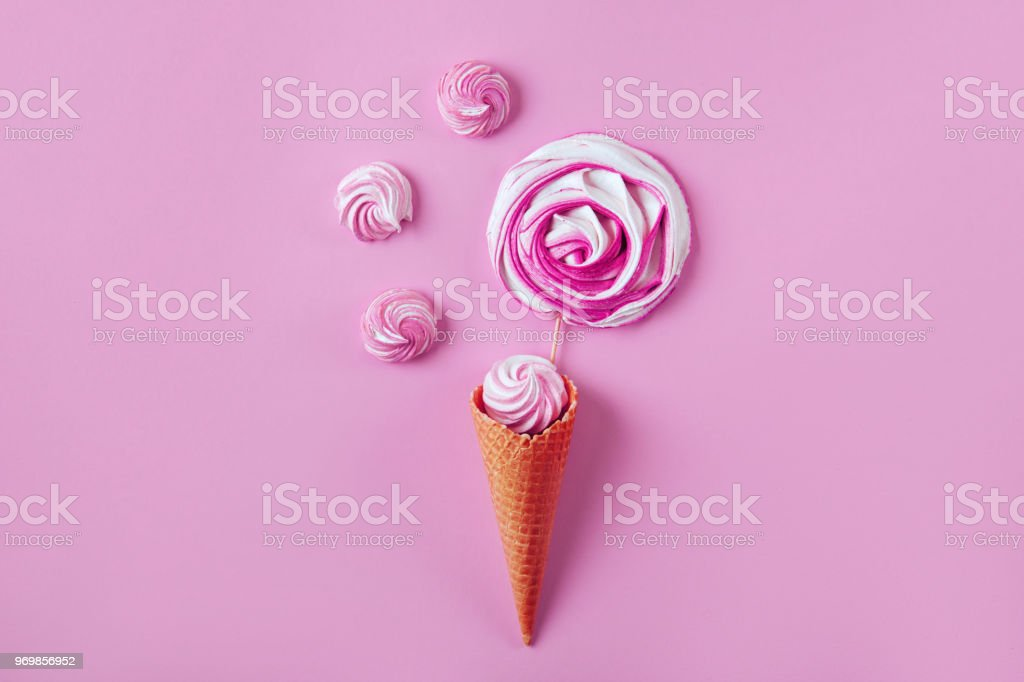 Violet candy on pink pastel background stock photo