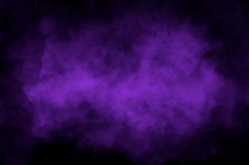 Violet cloud over black background