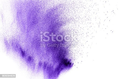 918139336 istock photo Violet color powder explosion cloud isolated on white background.Closeup of purple dust particles splash isolated on  background. 905094626