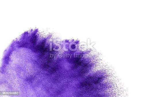 918139336 istock photo Violet color powder explosion cloud isolated on white background.Closeup of purple dust particles splash isolated on  background. 905094682