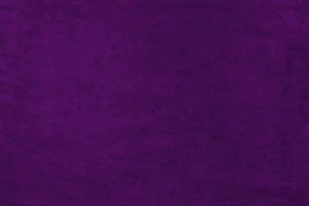 violet color velvet texture background - violet stock photos and pictures