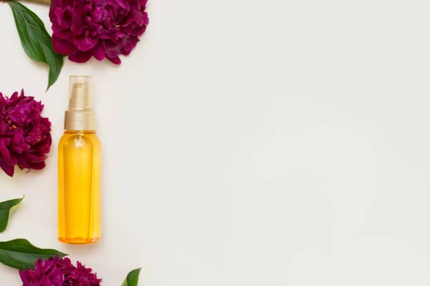Violet flowers with aromatherapy essential oil glass bottle on white picture id1254521198?b=1&k=6&m=1254521198&s=612x612&w=0&h=klejirzkqstv jmc5 bhslza0pyinn0mjkk2xco0iow=