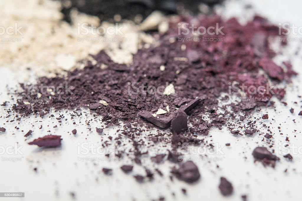 violet, lavender, cream and black makeup pigment powders stock photo